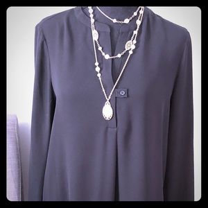 Build your work wardrobe with this black tunic.